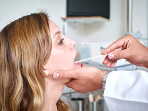 Woman having a throat examination